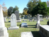 Looking toward the current Raleigh Hebrew Cemetery; a St. Augustine's College building is in the...