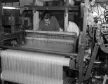 Man working at textile loom.