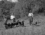 Men with Plott Hounds in field.