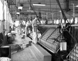 Men working in Cramerton Mills textile plant.