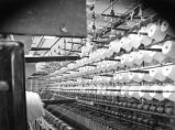 Rows of yarn in factory.