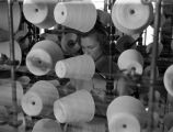 Woman with yarn skeins in factory.