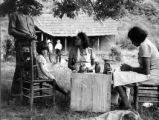 Women making pottery on Qualla Boundary.