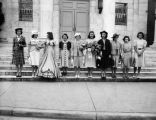 Women on steps of unidentified building.