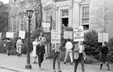 Students marching and holding free speech signs in Chapel Hill, March 6, 1966