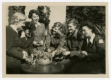 Annie Laurie Burton with Red Cross coworkers arranging flowers