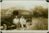 Currituck Public Library bookmobile with two seated men