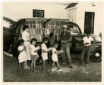 African-American children line up outside of Albemarle Region bookmobile