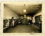 Davidson County Public Library interior with children and woman browsing the shelves