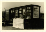Greensboro Public Library bookmobile, with sides open and banner