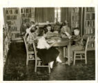 Harnett County Library interior view of children reading while sitting at tables