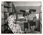 Johnston County bookmobile. Girls checking out books