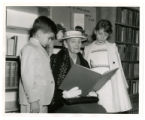 Mrs. Rosa Collins (seated) reading to Edwin Duncan, III and Katherine Reeves Duncan at Alleghany...
