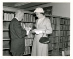 Mr. Floyd Crouse and Mrs. Elizabeth Hughey talk in front of the stacks at the opening of Alleghany...