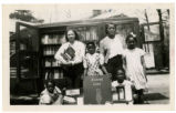 Bookmark contest winner, Geroline Graves (center), and others pose in front of bookmobile