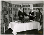 H. Leslie Perry Memorial Library. Mrs. H. M. King, Sara Napier, and Mrs. Hayle Biggers pose with...