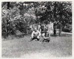 Robert Wunsch (English and Drama instructor, 1935-1945) teaching Drama students outside on the...